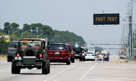 Traffic flows along U.S. 98 in Gulf Breeze on Tuesday. The Florida Department of Transportation is planning to widen a four-mile stretch of the highway from Bayshore Road to Portside Drive from four lanes to six lanes.