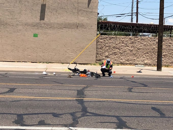 Phoenix police investigate a crash that killed a bicyclist near Buckeye Road and 16th Avenue, June 4, 2019.