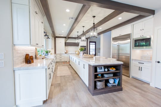 Homeowner Ray Heisler, who is in the commercial ceiling construction industry, was emphatic about the addition of these European Beechwood beams, which also help define the space without a wall.