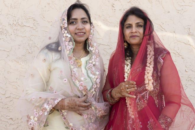 Farzana Salahudeen (left) and Julaiha Ariff both from Chennai, india, attend the Eid prayer at United Islamic Center of Arizona in Glendale on June 4, 2019.