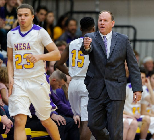 Mesa's head coach Shane Burcar on the sideline of their game on Friday, Jan. 12, 2018, at Mesa High School in Mesa, Ariz.