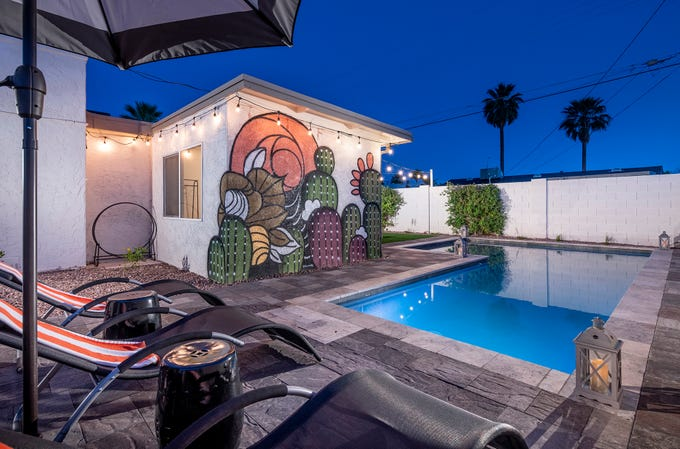 Murals were created to give this backyard its own special character.