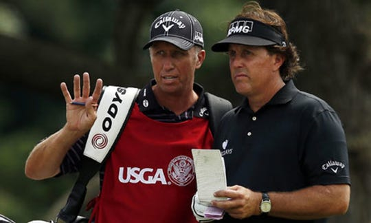 """""""Loopers: The Caddie's Long Walk"""" includes Phil Mickelson (right) and his caddie,  Jim Mackay."""
