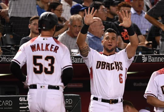 Christian Walker #53 of the Arizona Diamondbacks celebrates with teammate David Peralta #6 after hitting a home run off of Walker Buehler #21 of the Los Angeles Dodgers during the fifth inning at Chase Field on June 03, 2019 in Phoenix, Arizona.
