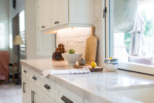 Under-cabinet lighting gives the kitchen a warm gentle glow, which Kellie Heisler, a ticket agent for an airline who wakes up at 1 a.m. to go to work, appreciates.