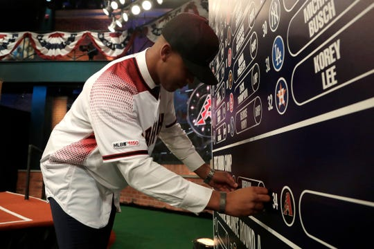 Right-hander Brennan Malone places his name on the draft board after being selected by the Diamondbacks on Monday.