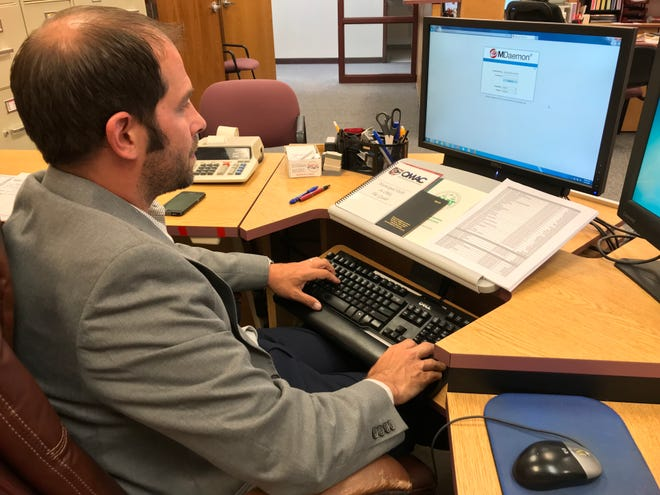 Port Clinton Auditor Cole Hatfield prepares to login to the city's email service, which was upgraded in 2019. This week, a computer virus infected the server.