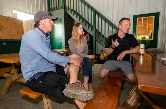 Owners Andy Holbrook, left, and Chris LeTarte, right, sit with Becca McFalda, a technician at Krown Rust Control inside one of the shop's bays Tuesday, June 4, 2019 in St. Clair.