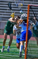York Catholic's Olivia Staples' shot on goal is caught by Springfield-Delco goalkeep Dana Mirigliano during the PIAA Class 2-A state girls' lacrosse semifinal, Tuesday, June 4, 2019.John A. Pavoncello photo