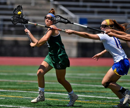 Sydney Mentzer of York Catholic moves in to shoot and score the Irish's first goal against Springfield-Delco during the PIAA Class 2-A state girls' lacrosse semifinal, Tuesday, June 4, 2019.