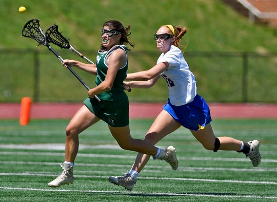 York Catholic's Shannon Staples, left, loses the ball to Isabelle Mastropietro of  Springfield-Delco during the PIAA Class 2-A state girls' lacrosse semifinal, Tuesday, June 4, 2019.