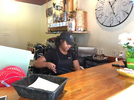 Brittany Boone works away at Boone's Vintage Café in Jacobus.
