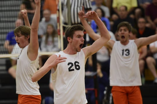 York Suburban's Declan Ridings throws his arm in the air after scoring a point in a PIAA Class 2A boys' volleyball semifinal Tuesday, June 4, 2019 at Red Lion.