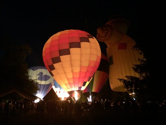 Hot-air balloons glow for hundreds gathered at Glen Miller Park for the 1st Bloom and Glow event last year.