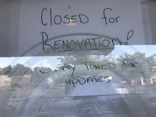 A sign in the window of the Otter Lodge, which closed last week.