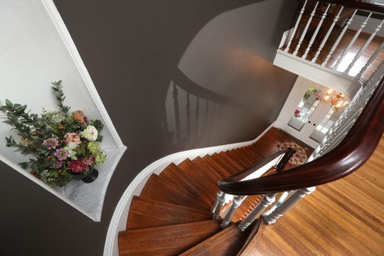 A curves staircase in the front foyer opens to a landing on the second floor.