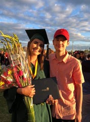 Madison Capobianco and her boyfriend Artem Shypuk photographed at her graduation. Capobianco was killed in an apparent drunk driving crash on Sunday, June 2, 2019, in Salem.