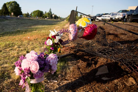A memorial is set up where three teens were killed in a car crash near the intersection of Cherry Avenue and Salem Parkway on June 3, 2019. The crash happened late June 2 when an alleged drunk driver ran a red light and crashed into their car, according to police.
