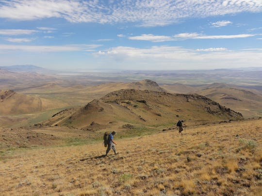 A hiker crosses the Pueblo Mountains on the Oregon Desert Trail.