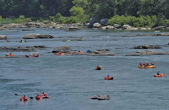Tubers and kayakers enjoy the Potomac River near its confluence with the Shennandoah River at Harpers Farry.