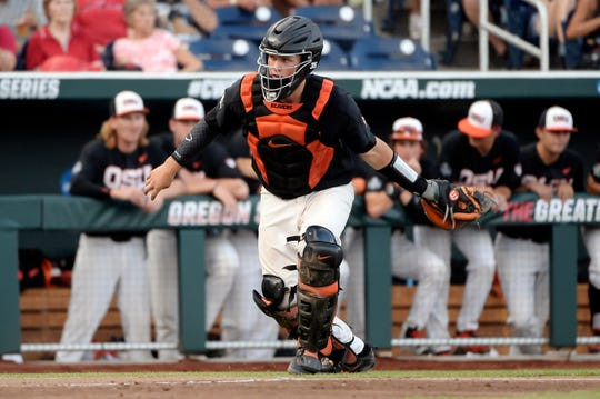 Jun 26, 2018; Omaha, NE, USA; Oregon State Beavers catcher Adley Rutschman (35) in action in the fourth inning against the Arkansas Razorbacks in game one of the championship series of the College World Series at TD Ameritrade Park. Mandatory Credit: Steven Branscombe-USA TODAY Sports