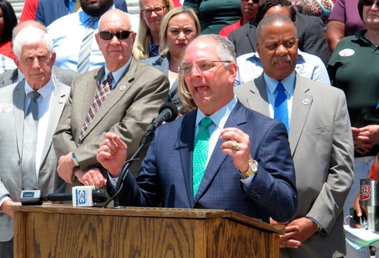 Louisiana Gov. John Bel Edwards, surrounded by public school leaders, speaks in support of the Senate version of next year's K-12 public school financing formula, which includes a $39 million block grant increase for districts, on Wednesday in Baton Rouge.