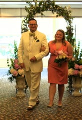 Thomas G. Jackson Sr. escorts daughter Demoiselle Deb Rebecca Jackson at the    Summer Announcement Brunch. She was among eight college coeds introduced. Floral Designer Kyle Loyd created the pink-and-white florals.
