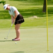 O'Gorman's Shannon McCormick putts on No. 7 (yellow) during the final round of the state Class AA girls golf tournament on Tuesday at Cattail Crossing Golf Course in Watertown.