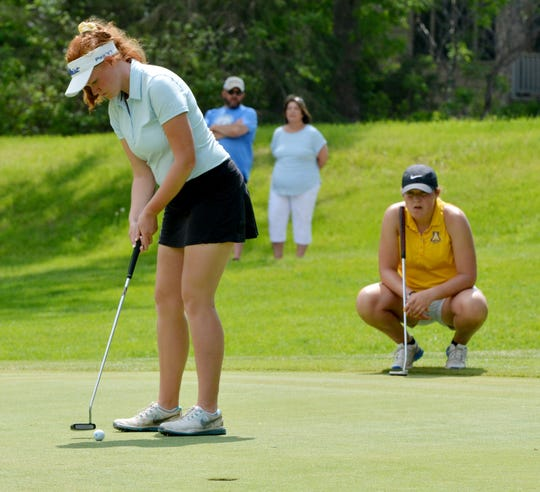 O'Gorman's Jenna Sutcliffe putts on No. 7 (Yellow) during the final round of the state Class AA girls golf tournament on Tuesday at Cattail Crossing Golf Course in Watertown.