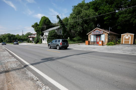 A view looking south down Lone Pine Avenue at buildings that once housed the Sequiota Bike Shop and One of a Kind.