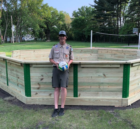 Ian Cairns, 15, of Sauk Rapids poses in front of the Gaga Ball pit he made for his Eagle Scout project.