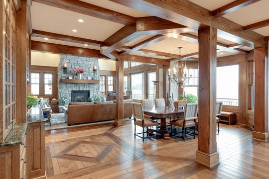 Opposite the hearth and mantle lays the home's formal dining room flanked with interior architectural columns of its own.
