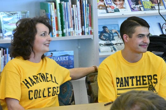 Canyon View's Mason Lyman (right) sits with his mom, Celesta, during his signing ceremony.