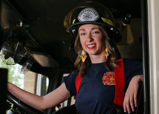 Miss Wisconsin Rapids Area Danielle Moon poses in a fire engine on June 3, 2019, at the Biron Volunteer Fire Department in Biron. Photographer Tork Mason earned a first-place award for portrait or artistic photo for the image in the Wisconsin Newspaper Association's 2019 Better Newspaper Contest.