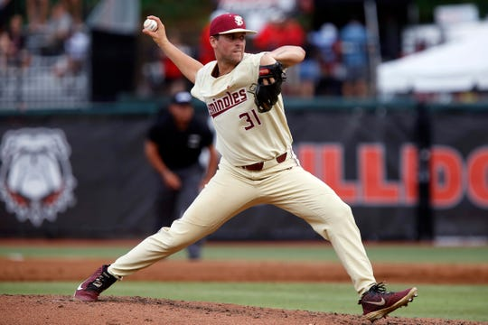 Florida State pitcher Conor Grady (31) delivers during an NCAA college baseball regional game against Georgia, Sunday, June 2, 2019, in Athens, Ga. Florida State won the game 10-1. (Jenn Finch/Athens Banner-Herald via AP)