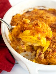 Cheesy Southern Squash Casserole gets a flavor pop from bacon.
