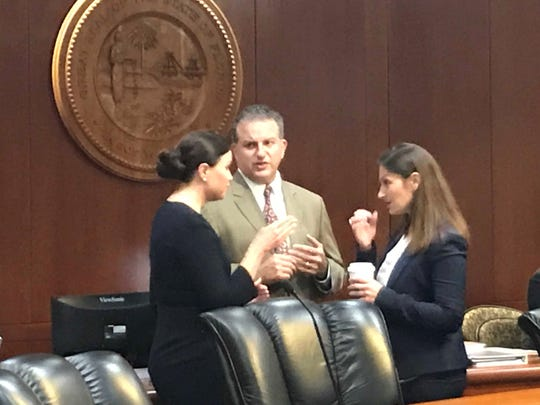 Attorney General Ashley Moody, CFO Jimmy Patronis and Agriculture Secretary Nikki Fried (From left to right) have a brief discussion before start of Tuesday's cabinet meeting on Florida territory.