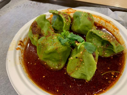 Xi'an Famous Foods, 8 Liberty Place, New York, features spicy and sour spinach dumplings.