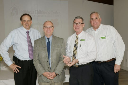 Hibiscus CEO Matt Markley, second from left, with Community Partner of the Year Winner Publix Supermarkets representatives Brett Tessier, left, Greg Rogoline and Jamie Laviolette.