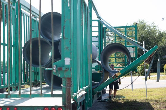 Advanced Drainage Systems truck driver Jim Skaggs unloads pipes for a drainage project Wednesday, May 29, 2019, in the Paradise Park neighborhood in unincorporated St. Lucie County. The final phase of a $1.75 million drainage project in the neighborhood is expected to wrap up in January, according to Patrick Dayan, project manager.