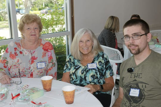 Hibiscus Treasure House Thrift Store volunteers Isabel Engel, left, Judy Axford and Adam Williamson.