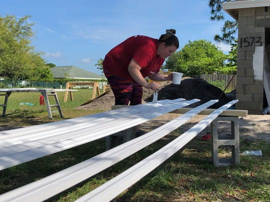 Brooke Stetson, relationship banker at Bank of America, helps paint and prepare a Habitat for Humanity home for future homeowners, Jata and Samuel Moise of Port St. Lucie. On May 4, nearly a dozen Bank of America volunteers worked with Habitat for Humanity of St. Lucie County to build the house.