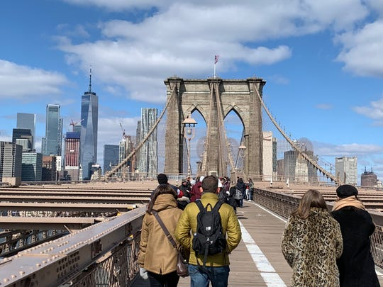 Tourists can crowd the free Brooklyn Bridge connecting New York City's Brooklyn and Manhattan boroughs. The views walking or bicycling into Manhattan can be spectacular.