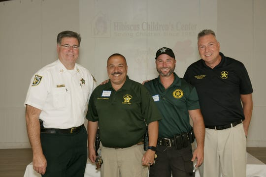 St. Lucie County Sheriff Ken Mascara, left, Sgt. David Cabrera, Deputy Sheriff Jonathan LaSasso and Civilian Manager Trevor Morganti at the Hibiscus Children's Center Volunteer Appreciation Luncheon.