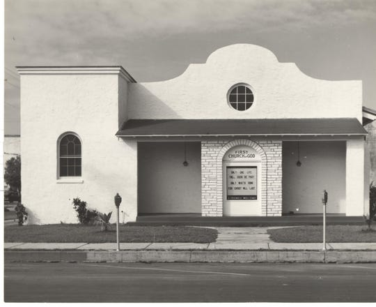 """The Church of God – mission-style architecture – was located (and still is) at the corner of 14th Avenue on the west side and 19th Street, south of Post & Vine restaurant.  It is hidden behind a number of small businesses.  If you look at the roof line behind the businesses you can see the """"mission"""" roof line.  That architectural style was very popular in the 1920s."""