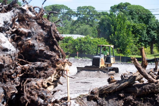 Loren Jock Trucking equipment operator Gage Lydon smooths out land as a crew makes progress toward creating a retention pond Wednesday, May 29, 2019, in the Paradise Park neighborhood in unincorporated St. Lucie County. A voter-approved sales tax increase is allowing the county to finish a drainage project in the neighborhood that was started in 2005.