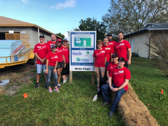 Wells Fargo employees recently volunteered their time to work alongside a future St. Lucie Habitat for Humanity family to build a home in Port St. Lucie. Pictured are, from left, Meade Rankin, Mauricio Martinez, Yvette Zamoysia, Shelly Thomas, Sandra Rider, Bonnie Simes, Ademil Castrillo, Josh Lau, Lisa Broom, Earl Margan and Richard Giessert.