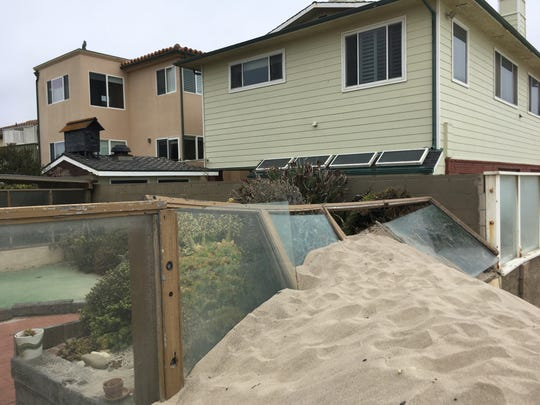 A collapsed fence off Brunswick Lane, which is catty-corner to the property of Juli Scott and Scott Howard, who are suing the city of Ventura because of sand that comes onto their property.