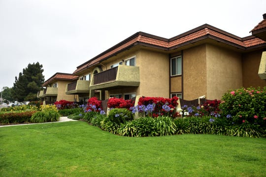 Lush landscaping decorates an apartment complex in Oxnard on Tuesday. A high-profile bill passed recently by the California Assembly would impose rent control limits on annual increases for the vast majority of renters. If approved by the state Senate and signed by Gov. Gavin Newsom, it would make California the second state to provide such protections.