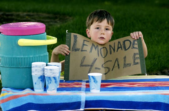 "In this file photo, a boy tries to sell lemonade from a stand on the sidewalk. Currently, Visalia offers no ""entrepreneurship opportunities"" to street vendors."
